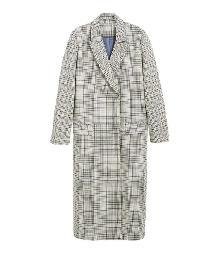 Suoralinjainen ruutukuosinen takki kiinnitetään piilonapeilla. Takana oleva halkio helpottaa kävelemistä, 129 e, KappAhl Limited Edition, koot S–L.